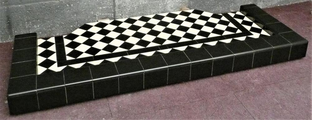 Diamond pattern hearth with stripe and kerb