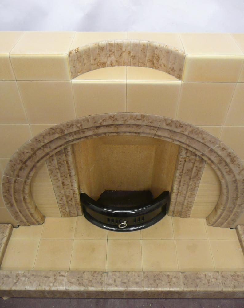 The fireplace has a shelf with finger tile detail.