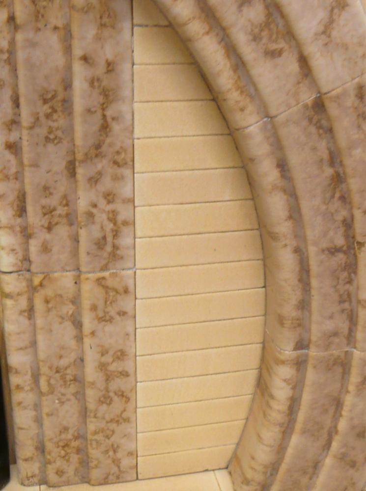 Horseshoe arch tiled Fireplace with original hearth
