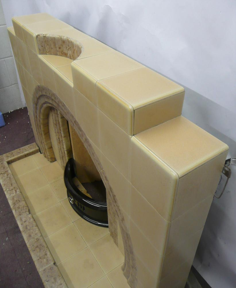 1950's original tiled Fireplace with rare surviving Horseshoe arch.