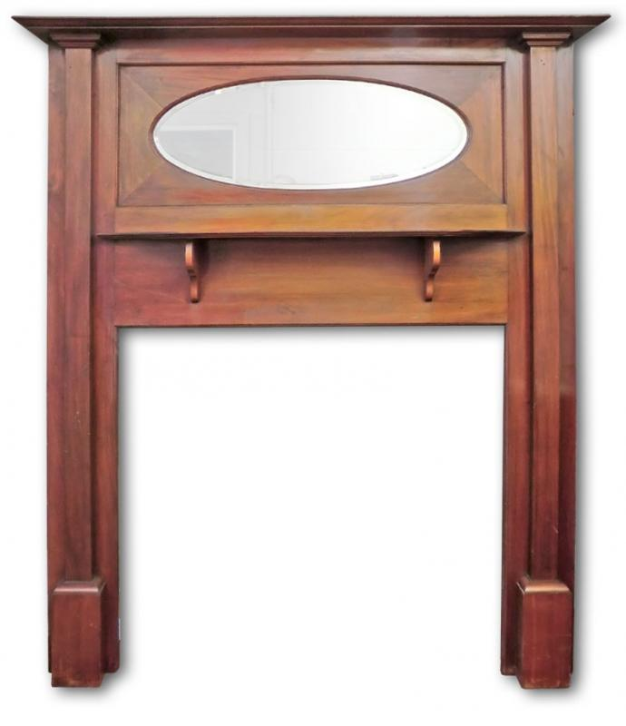 Mahogany fire surround with oval mirror