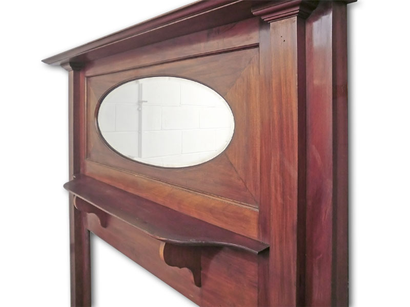 Oval mirror and moulded central shelf