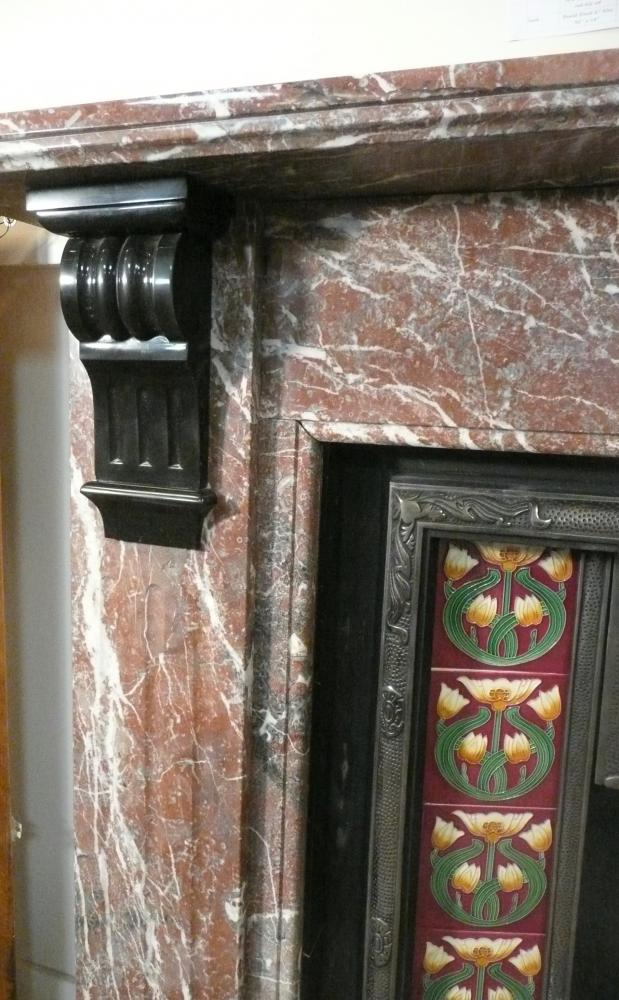 An impressive Victorian Rouge marble mantel with Belgian black grooved corbels