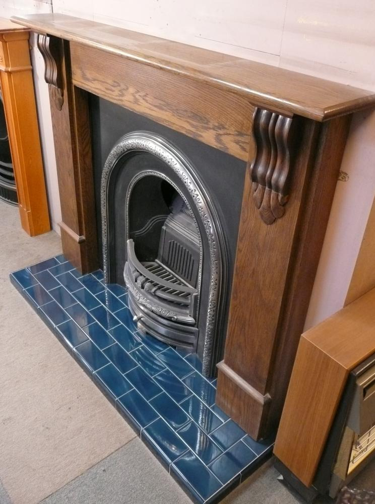 Dark Oak Mantel and Cast Iron Arch insert with Midnight Blue tiled Hearth