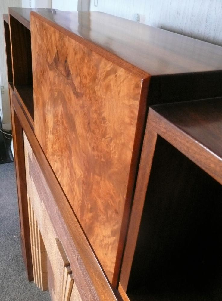 This piece features book matched, burr walnut panels in the legs and central frieze section