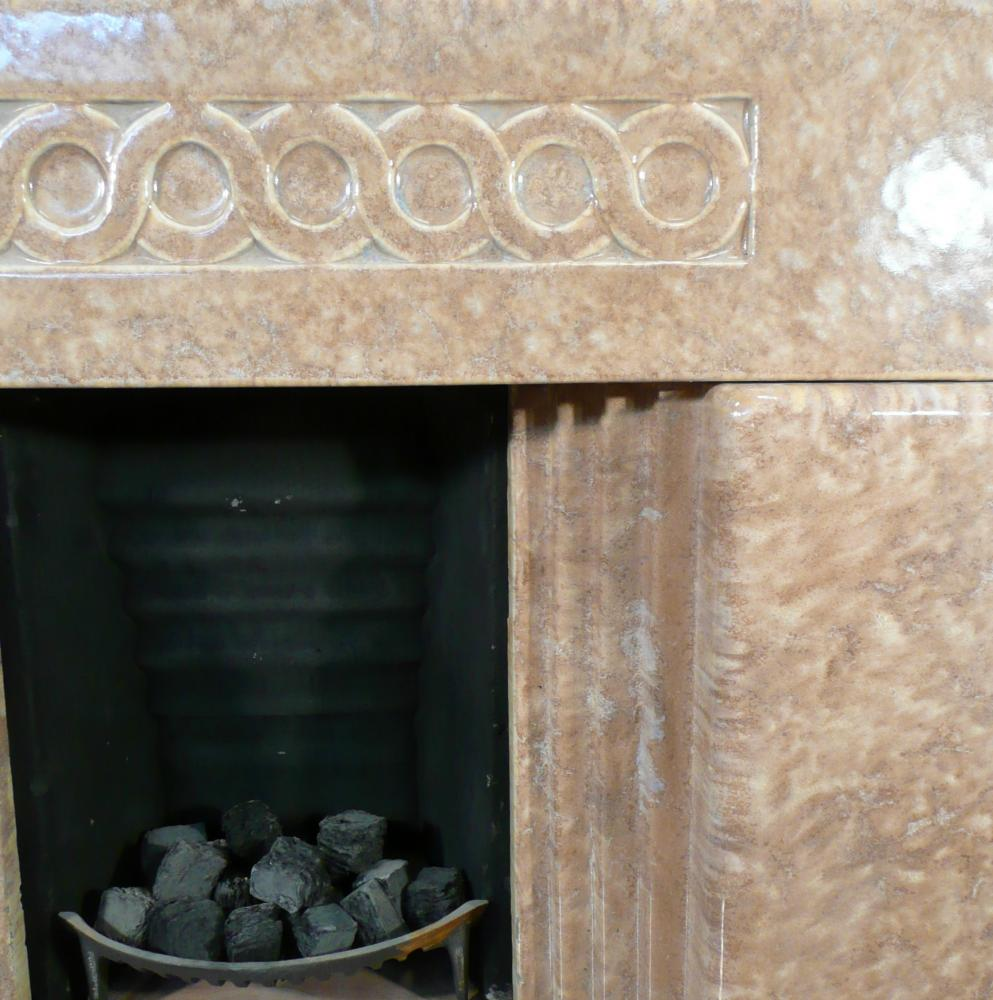 Glazed Faience block fireplace with its original hearth