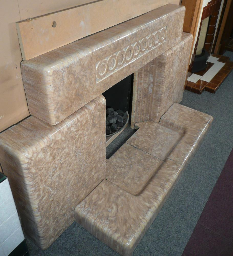 An original 1930's / 1940's  Glazed Faience block fireplace with its original hearth