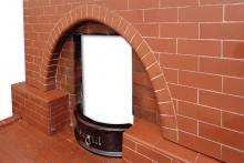 Brick fireplace arch and hobs detail