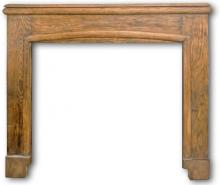 A chunky oak mantel from the late 1920s.