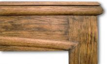 Oak mantel from the late 1920s showing semicircular moulding and caddy top